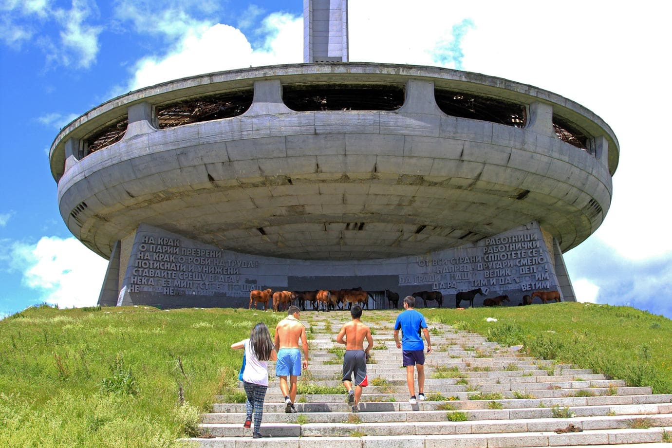 Messages written in giant Cyrillic letters on either side of the main entrance greet you as you walk up the stairs to Buzludzha