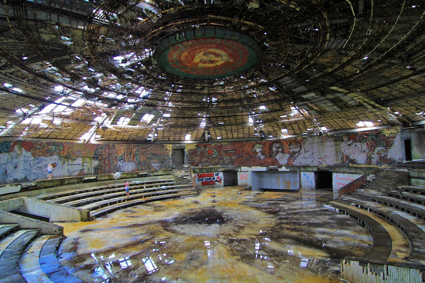 The main auditorium, much like the rest of Buzludzha, is in complete disrepair with rubble and glass on the floor