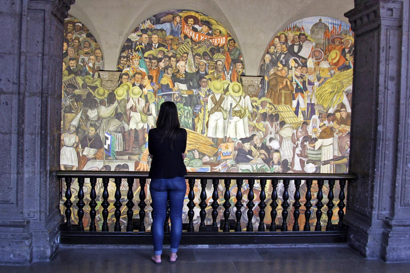 Looking at a mural in the National Palace of Mexico