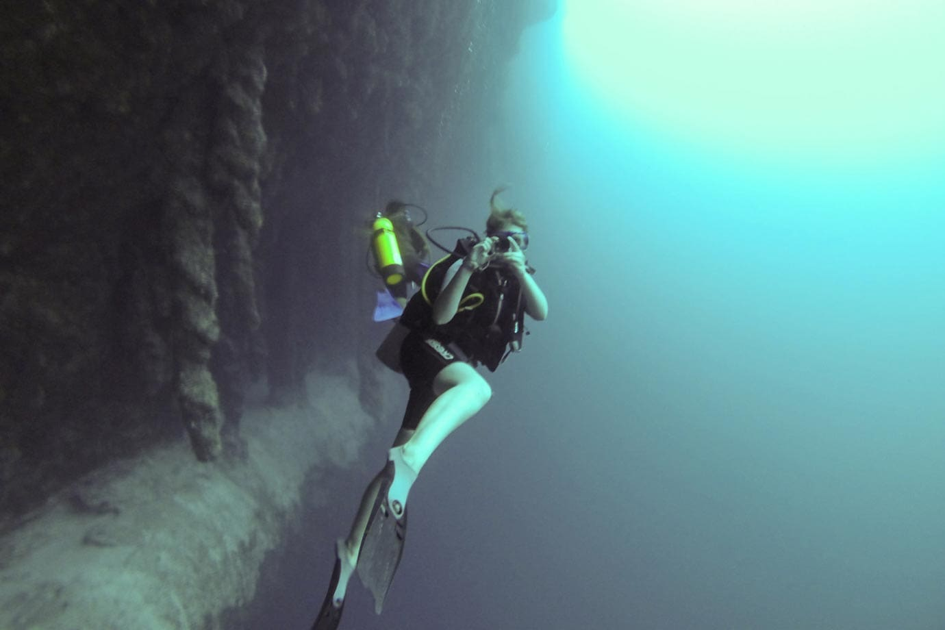 Where else in the world can you swim in and out of stalactites in murky blue water?