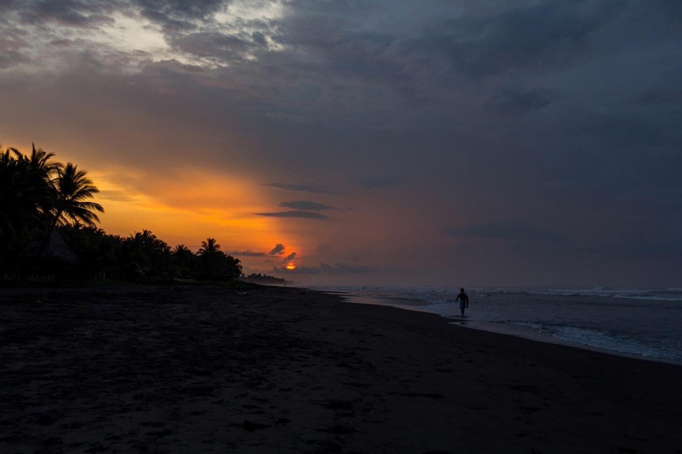 Surfing in El Salvador at sunrise