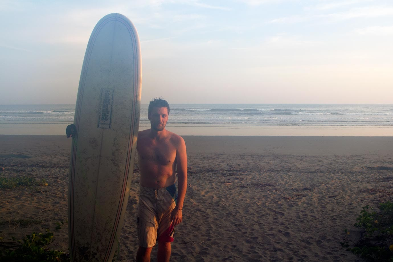 Brian surfing on a hazy morning