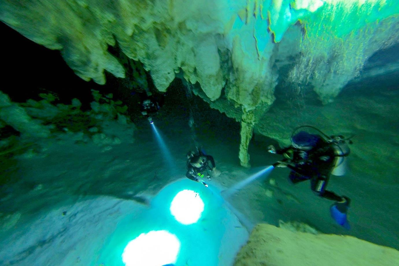 Diving inside cenote Dos Ojos