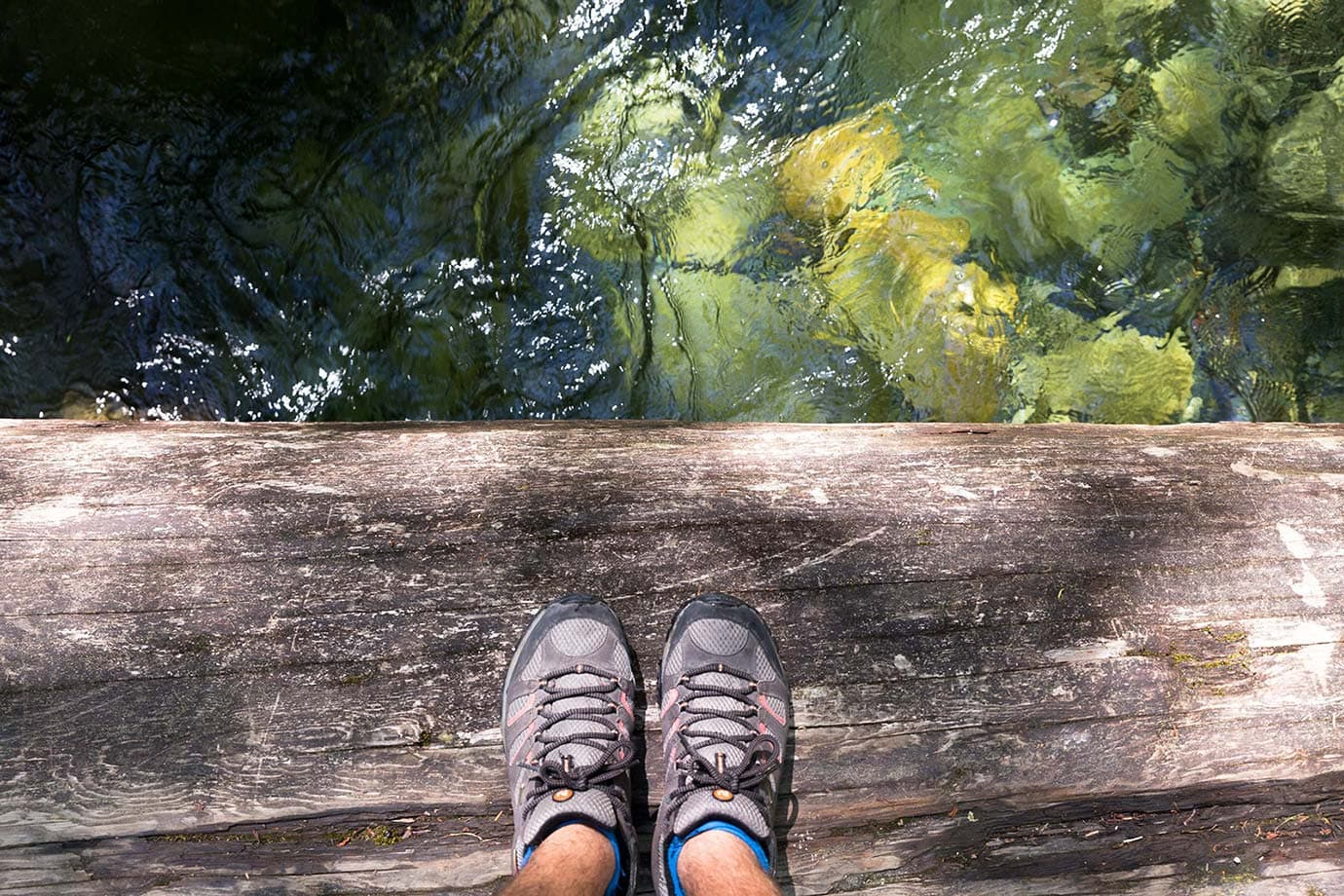 Walking over one of the log bridges at Shannon Falls