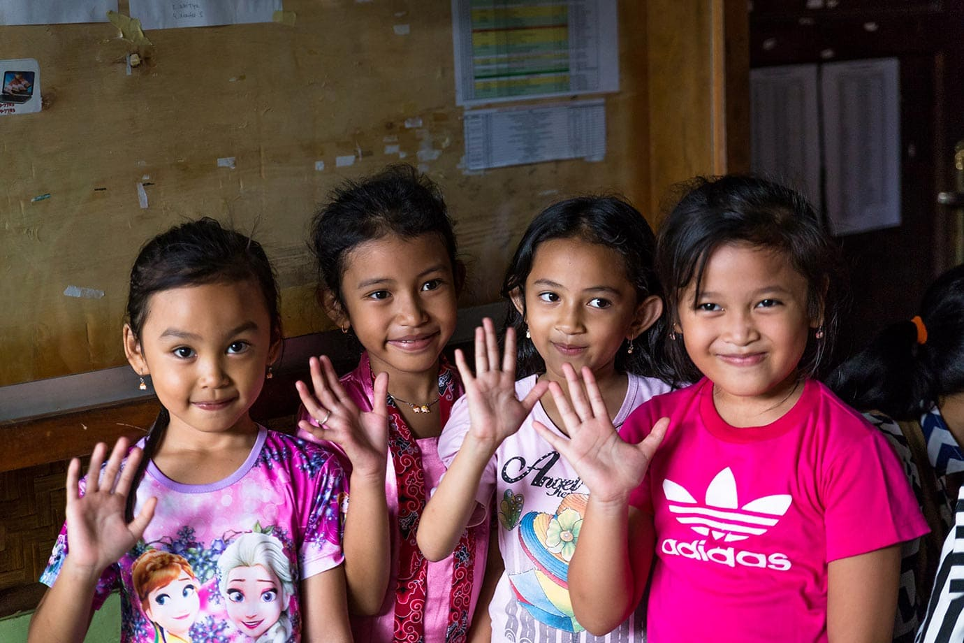 Kids waving in Indonesia
