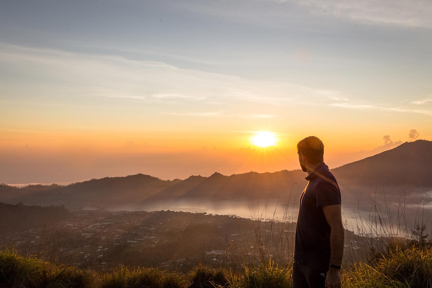 Standing at the top of Mount Batur