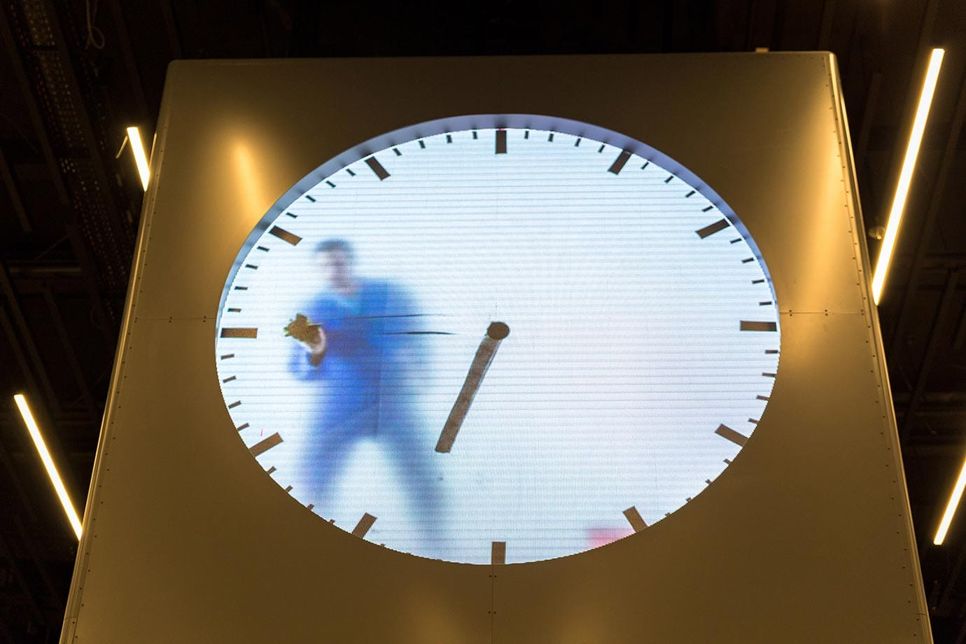 Man in the clock at Schiphol Airport