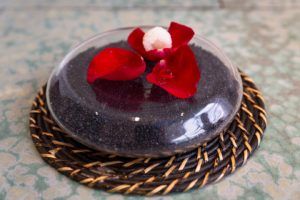 Rose petals with gin and a frozen lychee at Disfrutar
