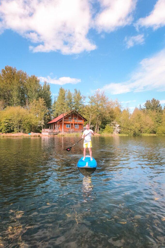 paddleboarding log house holidays